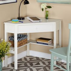 Make the most of your square footage with this white wood corner computer desk that is perfect for a kids room. This desk has enough room for doing homework or working on a laptop while conserving space by taking up just one corner of your room.