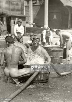 Imperial Japanese Army soldiers bathe during the SinoJapanese war on September 4 1937 in Shanghai China