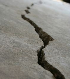 This concrete crack repair starts by cutting the spalled area or just cleaning joints and honeycombed areas from debris. Inject epoxy to fill and bond the joints.