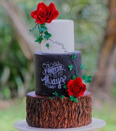 Rustic chalkboard and tree stump wedding cake with edible sugar flowers