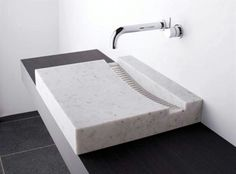 This bathroom counter top sink is not a typical option. Made from Marble with the angles of the basin directing water towards the waste. Paired with an outstanding wall mounted tap, the basin makes a. Bathroom Sink Organization, Bathroom Sink Design, Sink Organizer, Bathroom Basin, Bath Design, Sink Faucets, Basins, Bathroom Colors, Lavabo Design
