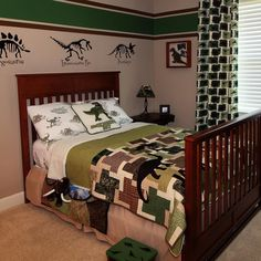Jack's Dinosaur bedroom.  Inspired by his love of dinosaurs and the stuffed dinosaur I made for him while living on the Space Station (displayed in a shadow box on his wall beside the bed).  #DIY #KidsBedroom #Dinosaurs