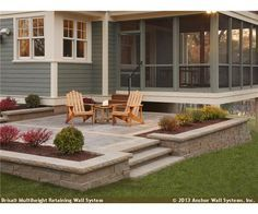 Raised patio featuring Brisa® wall system complements a screen porch too.