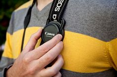 The Lens Cap Strap Holder