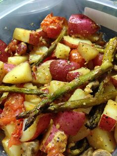 Red potatoes, mushrooms, asparagus, tomatoes, and lemon pepper all made in the oven.