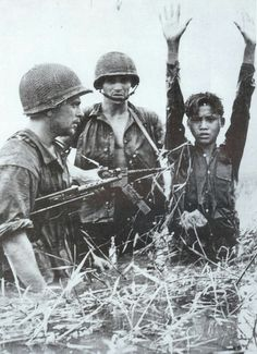 French soldiers with captured Viet Minh, in first Indochina war. ~ Vietnam War