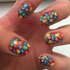 It's like someone spilled a bag of M on her nails!
