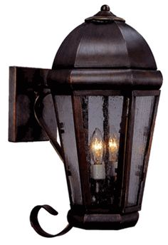 The Capital Wall Mount Lantern with Bracket by Lanternland, shown in Antique Copper with Seedy Glass, is made by hand in America from the high quality brass and copper. Designed to last for decades this lantern includes our exclusive lifetime warranty. Available in wall light and wall sconce versions as well as your choice of seven fabulous finishes and four distinctive styles of glass, this lantern pairs well with traditional, Colonial, Colonial Revival and Mediterranean homes.