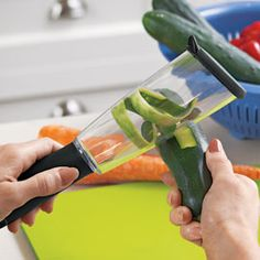 The Veggie-Peel Your sink and counter stay clean because it contains the mess!