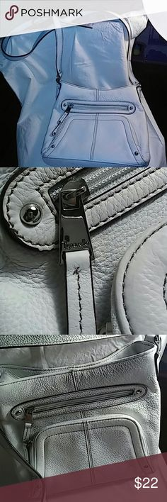 """New Tignanello white cross body bag Nwot white color, cross body bag by """"Tignanello"""" genuine leather, long straps; silver hardware with designers mark; outside has two zippered pockets in the front and one in the back; inside is lined in cream color material ( feels water resistent); high quality; just lovely for the summer; 8.5"""" long x 9.5"""" tall x 2"""" wide: Tignanello Bags Crossbody Bags"""