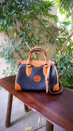 large vintage Dooney and Bourke satchel, black and tan all weather leather