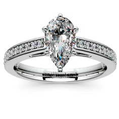Present your darling with classy Pear-cut sparkle in a simple yet stylish setting: The Pave Cathedral Diamond Engagement Ring in sleek Platinum.  http://www.brilliance.com/engagement-rings/pave-cathedral-diamond-ring-platinum-1/4-ctw