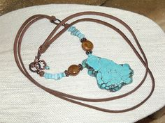Long Bohemian Necklace - Turqoise Pendant Leather Necklace - boho hippie chic indie art jewelry - December Birthstone - healing balance by CJKingOriginals on Etsy https://www.etsy.com/listing/495670629/long-bohemian-necklace-turqoise-pendant
