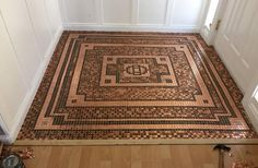 Copper Penny Floor Foyer Project done by Kelly. She separated dark from newer pennies created a mosaic pattern.
