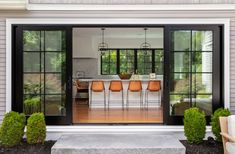 This House Has a Dog Shower In Its Laundry Room — House Beautiful Center Hall Colonial, Island Stools, Counter Stools, Kitchen Island, Colonial Style Homes, Dog Shower, Transitional House, Indoor Outdoor Living, Sliding Glass Door