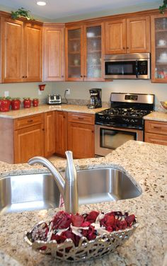 Using frosted glass in the upper cabinets creates visual interest without putting the daily dishes on display.