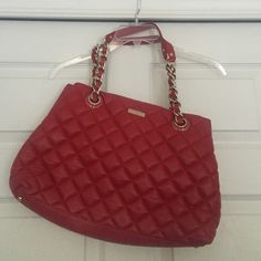 """Quilted red leather bag Roomy leather authentic Kate Spade bag! Great for work or weekend errands. Lots of pockets for make up, your cell, iPad and more! Dust bag included with purchase. Dimensions: approximately 16"""" w by 18"""" high (including strap). kate spade Bags Shoulder Bags"""