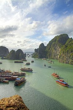 Lots and lots of junk boats transporting tourists around Halong Bay, Vietnam