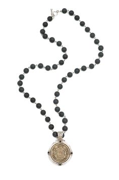 """28"""" sandblast black jasper stone and silver wire with antiqued sterling silver-clad FK jet cabochon bezel and antiqued brass-clad Cuvee Royal medallion - See more at: http://www.frenchkande.com/product-detail.php?g=RB90-Z#sthash.nzPqx4tG.dpuf"""