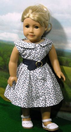 1950s Blue and White Set fits 18 Inch Dolls like Mary Ellen. Included are a shirt, skirt, shorts, belt and pedal pushers. Added was a second white blouse. This skirt and top are in a navy and white cotton print with turquoise accents. The gathered skirt closes in front with Velcro covered by tiny white buttons. Elastic in the back for chubbier gals. This blouse has a wide neckline with rounded collar and is sleeveless. A navy grosgrain belt cinches the waist.