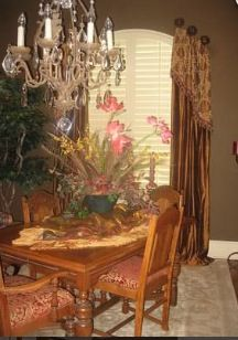 Window treatments - elegant drapes paired with arched shutters