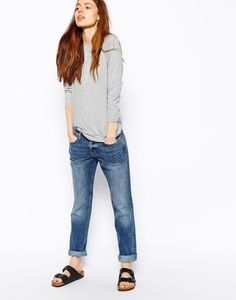 Pair boyfriends jeans and birks for a casual look.