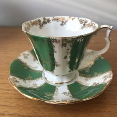 Royal Albert Vintage Teacup and Saucer Pattern: Marquis Series  This is a stunning bright green and white striped teacup and saucer. In between the stripes is a floral gold garland that also encircles the inside edge of the cup. The edges, handle and foot are trimmed in gold on this