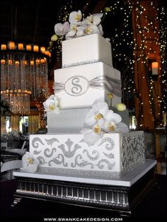 Gorgeous grey & white wedding cake.  Don't necessarily like the colors or the flowers, but love the Monogram S