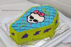 Monster High Birthday Party ideas. Printables, banner, labels and a Monster High Cake in the shape of a coffin. By Canadian Mom Blogger