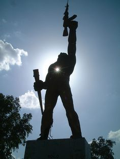 When we were stationed in Managua, long ago, this statue amazed me...the soldier was aiming the skies.... Managua, Nicaragua