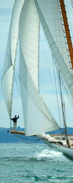 He is the king of the ocean on this beautiful classic sailingyacht