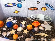 Where was this idea when I was still teaching Pre-K! You could use dyed rice also! Space sensory bin, cool!