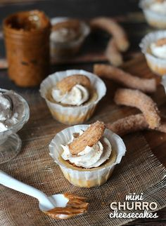 Mini Churro Cheesecakes ~ A Cinnamon graham cracker crust with a cinnamon vanilla cheesecake smeared with dulce de leche, topped with cinnamon whipped cream and a churro!