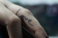 love on finger tattoo