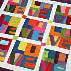 Colorful and Cheery. Love Quilt from Quiltycat blog..