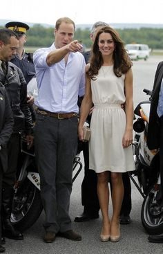 I love her dress. And her shoes. And her little clutch. :)