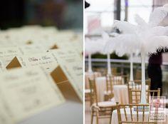 White feather centerpieces and escort cards via IndianWeddingSite.com