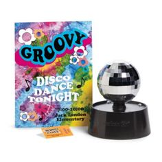 Julie's Disco Accessories-  Your girl can imagine that her Julie doll is attending a disco-themed school dance, just like in the 1970s! This set includes a doll-sized ticket and poster for the dance, plus a mirrored disco ball that really lights up and spins at the touch of a button to make the dance floor sparkle. Z