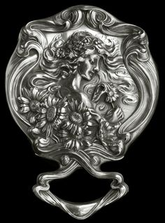 This is not contemporary - image from a gallery of vintage and/or antique objects. ART NOUVEAU  Hand Mirror  Silver