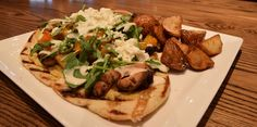 Rotisserie Chicken Thigh Sandwich with roasted fall vegetables, hummus, lemon tahini, feta, lemon-cumin yogurt and cilantro on flatbread, served with za'atar spiced roasted potatoes (lunch) | Green Valley Grill | Greensboro, NC