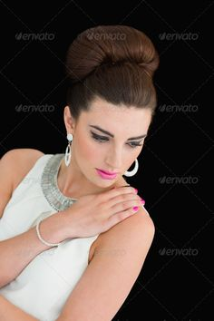 Woman with beehive and pink lips posing on black background ...  20s, attractive, beautiful, beauty, beehive, bracelet, brown hair, brunette, cat eyes, caucasian, copy space, earrings, eyeliner, face, female, glamorous, gorgeous, happy, indoors, lipstick, looking down, made up, makeup, mod, model, out of context, pale, perfect, pink lips, pink nails, posing, pretty, sexy, sixties, smiling, style, white background, woman, young adult