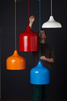 Popper Pendant by Andre Hnatojko  Inspired by the shape of party poppers, they are made of recycled aluminium, available in a number of bright colours and four different sizes.