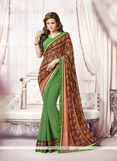 Rich look attire to give your a right choice for any party or function. Include your self of the glamour of a season with this elegant green georgette designer saree. The appealing embroidered and pat...