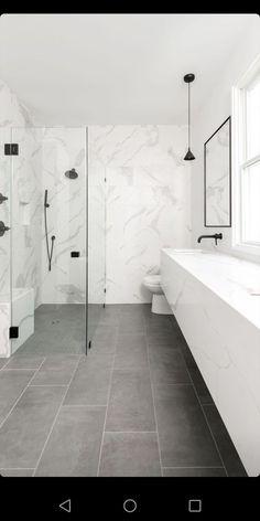 Modern bathroom with quartz floating vanity, matte black wall-mount faucets & fi. Modern bathroom with quartz floating vanity, matte black wall-mount faucets & fixtures and curbless Bathroom Renos, Bathroom Flooring, Bathroom Renovations, Bathroom Fixtures, Small Bathroom, Bathroom Black, Bathroom Cabinets, Bathroom Ideas, Bathroom Showers