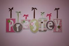 Name on the wall using wooden plaques from hobby lobby and scrapbook paper/accssories