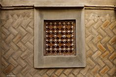 architectural detail of mud house in Djenne, Mali by Phil Marion