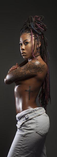 Gorgeous Locs and I like the cross tat                                                                                                                                                                                 More