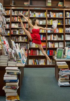 "Dancer in bookstore, reading while dancing. From ""Dancers Among Us: A Celebration of Joy in the Everyday,"" by Jordan Matter."