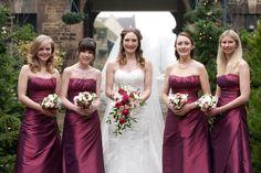rasberry wedding flowers | Bride with bridesmaids dressed in raspberry pink