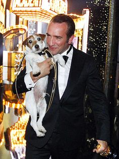 Best Actor winner Jean Dujardin keeps a tight hold on the two most important men of the night – his Oscar, and his The Artist costar, Uggie. (Psst: We bet someone's getting a lot of Beggin' Strips tonight!)
